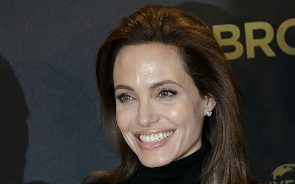 Director Angelina Jolie poses for photographers during a photo call for her film 'Unbroken' in Berlin, Germany in November 2014. (AP Photo/Michael Sohn, File)