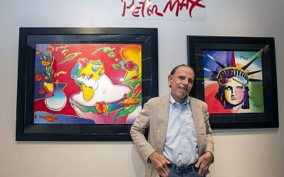 Artist Peter Max poses for a photo during his retrospective with the Road Show Company exhibit in Northbrook Court mall in Northbrook, Ill. Since he charged onto the pop-art stage a half-century ago, the progenitor of psychedelic art has stamped his creative presence on practically everything from the sides of an airliner and the hull of a Norwegian Cruise Lines ship to commemorative US postage stamps and, most lately, an endless string of art galleries stretching from one end of the United States to the other. (photo credit: Barry Brecheisen/Invision/AP)