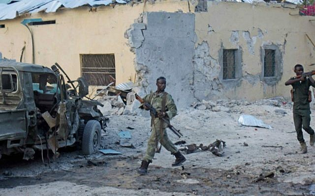 Somali soldiers take position after a bomb that was detonated at the gate of one of Mogadishu's most popular hotel on Friday, March, 27, 2015. (photo credit: AP/Farah Abdi Warsameh)