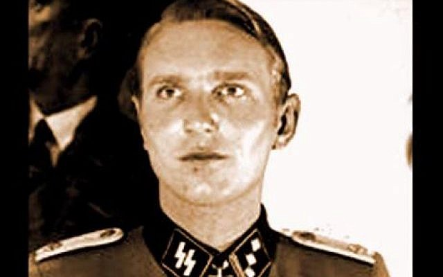 Wanted Nazi war criminal, Søren Kam. (photo credit: Youtube screenshot / STOP CAPITALISME)