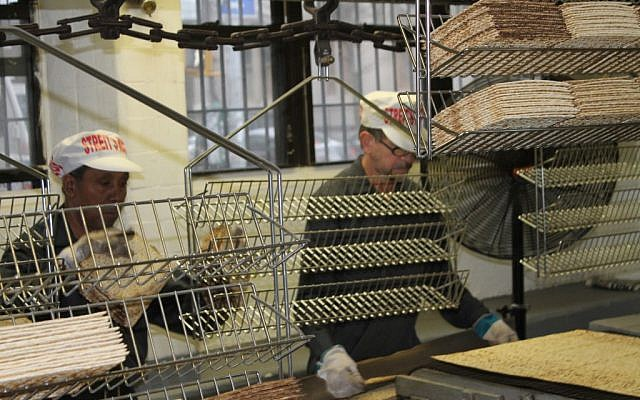 At the Streit's factory on the Lower East Side of Manhattan, matzah is broken into pieces and sent to be packaged in the same way it has been for over half a century. (Gabe Friedman/JTA)