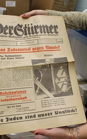 A copy of the Nazi weekly Der Sturmer from February 1943, with a headline at bottom left reading 'Bolshevism is radical Jewish domination.' (Uriel Heilman/JTA)