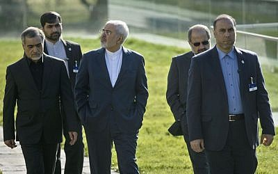 Iranian Foreign Minister Javad Zarif, center, takes a walk prior to meetings at the Beau Rivage Palace Hotel, in Lausanne, Switzerland, Saturday March 28, 2015. (photo credit: AP/Brendan Smialowski)