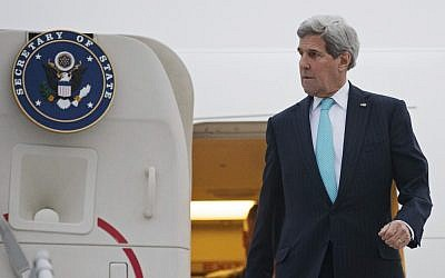 US Secretary of State John Kerry disembarks from his plane as he arrives in Geneva, Switzerland, Sunday March 15, 2015 (AP Photo/Brian Snyder, pool)