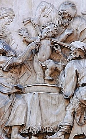 This plaque at the Palazzo Salvadori in Trent, Italy, illustrates the supposed martyrdom of Simon of Trent at the hands of Jews. (Wikimedia Commons/JTA)