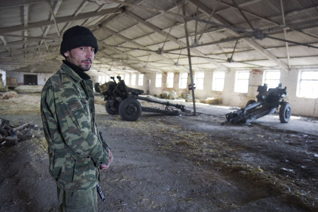 Bon A Pro Russian Rebel Stands On Guard In A Storage For Cannons In The Village