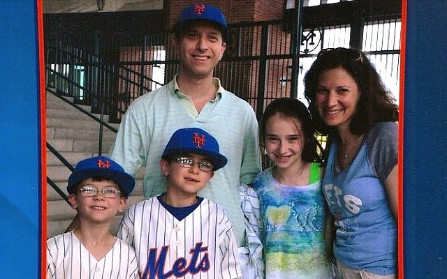 Rabbi Sharon Forman (right) with her husband and children at a Mets game in 2012. (Courtesy)