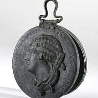 Bronze mirror with a woman's head in relief, Hellenistic period, late 4th–3rd century BCE from the Belfer Collection (photo credit: © The Israel Museum Jerusalem, Elie Posner)