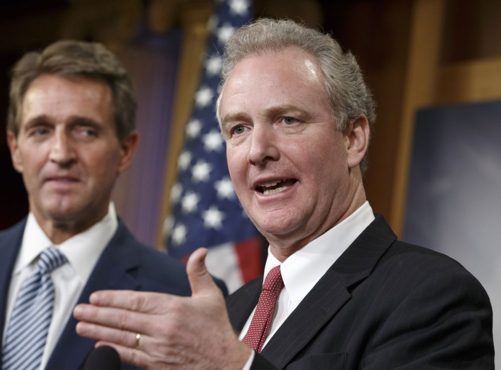 In this Dec. 17, 2014, file photo, Rep. Chris Van Hollen, D-Md., speaks as Sen. Jeff Flake, R-Ariz. listens during a news conference on Capitol Hill in Washington. Van Hollen says he will run for the Senate seat that will be open when Barbara Mikulski retires. (AP Photo/J. Scott Applewhite, File)