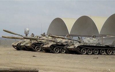 In this photo taken Tuesday, March 24, 2015, tanks seized recently by militiamen loyal to Yemen's President Abed Rabbo Mansour Hadi take positions at the al-Anad air base in the southern province of Lahej, 60 kilometers (35 miles) north of Aden, Yemen. (photo credit: AP Photo/Wael Qubady)