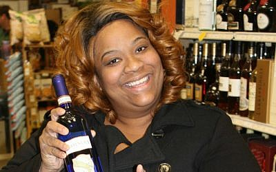 To Baltimore resident Joeann Wallace, selecting a kosher Moscato 'is well worth it' for the taste she enjoys. (Hillel Kuttler/JTA)