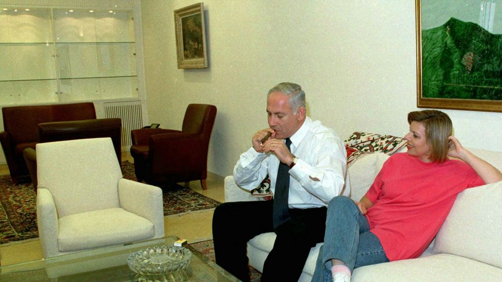 Netanyahu, during his first term in office, enjoying a cigar on September 28, 1997 (photo credit: AP Photo/ Zoom 77)