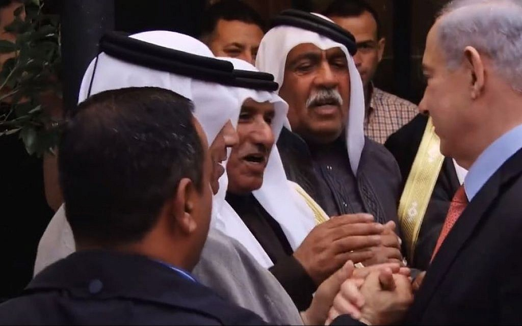 Benjamin Netanyahu embracing Israeli Arab leaders in Jerusalem on March 23, 2015. (Screen capture: YouTube)