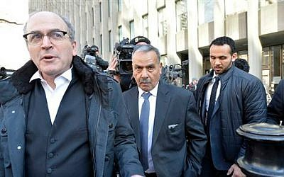 Mohammed Jaser, centre, father of Raed Jaser, leaves court after two men accused of plotting to attack a Via Rail passenger train travelling from New York to Toronto were found guilty of terror-related charges in Toronto on Friday, March 20, 2015. (photo credit: AP/The Canadian Press, Nathan Denette)