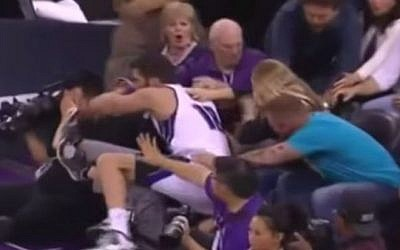 Omri Casspi crashes into a young spectator, March 22, 2015 (YouTube screenshot)