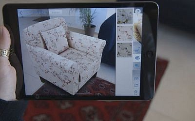 A virtual Shop Direct chair in a potential customer's living room, courtesy of augmented-reality technology (Courtesy)