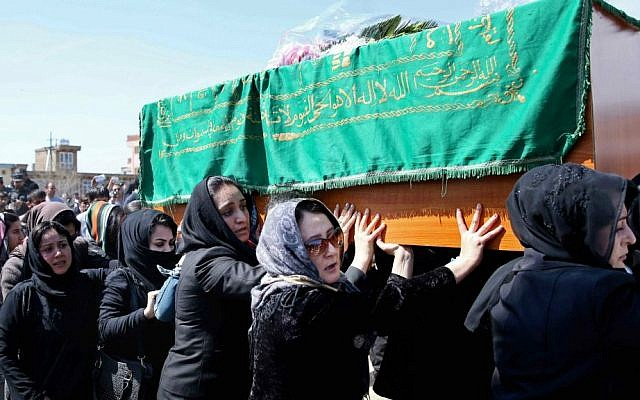 Afghan women rights activists carry the coffin of 27-year-old Farkhunda, an Afghan woman who was beaten to death by a mob, during her funeral, in Kabul, Afghanistan, Sunday, March 22, 2015. ( photo credit: AP Photo/Massoud Hossaini)