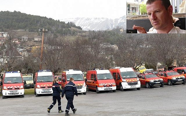 Emergency vehicles are parked on March 24, 2015 in the southeastern French town of Seyne les Alpes after a German Airbus A320 of the low-cost carrier Germanwings passenger plane crashed, killing all 150 people on board. Inset: Eyal Baum. (photo credits: AFP/BORIS HORVAT and Facebook)