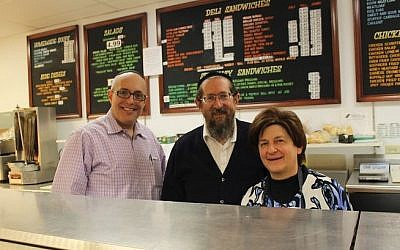 Joshua Horowitz, left, bought the East Side Kosher Deli in February 2015 from Michael and Marcy Schreiber, who had owned it for 17 years. (Photo credit: Uriel Heilman/JTA)