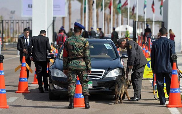 Egyptian security forces check a car outside the conference hall where the Arab League summit will be held on March 28, 2015, in Red Sea resort of Sharm El-Sheikh (photo credit: AFP / MOHAMED EL-SHAHED)