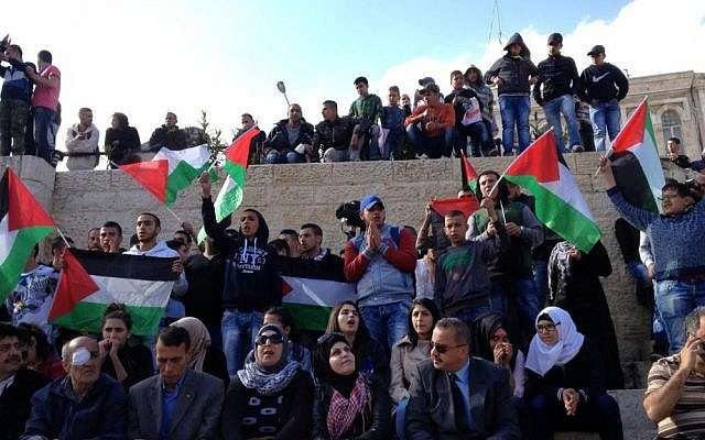 Palestinians singing nationalistic songs near Damascus Gate in the Old City of Jerusalem on Land Day, March 30, 2015. (Elhanan Miller)