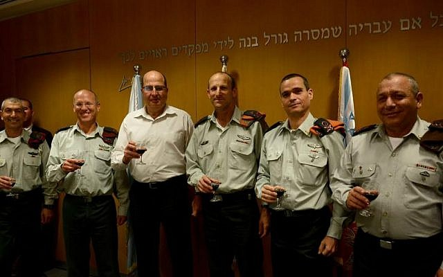 A General Staff changing of the guard on March 24, 2015, from right: Chief of the IDF General Staff, Lt. Gen. Gadi Eisenkot; incoming head of the Home Front Command, Maj. Gen. Yoel Strik; outgoing Home Front Command head Maj. Gen. Eyal Eisenberg; Defense Minister Moshe Ya'alon; outgoing OC Central Command, Maj. Gen. Nitzan Alon; incoming OC Central Command, Maj. Gen. Roni Numa (photo credit: IDF Spokesperson's Unit)
