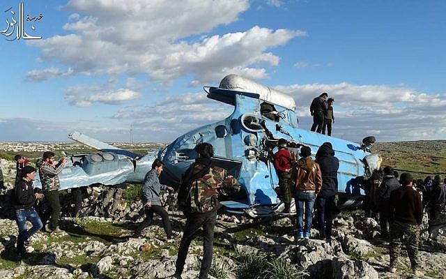 Illustrative: A Syrian helicopter crashes in rebel-held territory in Idlib province, March 22, 2015. (Idlib Media Center/Facebook)