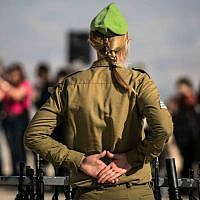 An illustrative photo of an IDF commander at a swearing-in ceremony for female recruits on February 18, 2015 (IDF Spokesperson's Unit/Flickr)