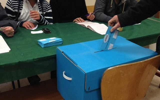 An Israeli votes in national elections in Jerusalem on March 17, 2015. (Times of Israel/Stuart Winer)