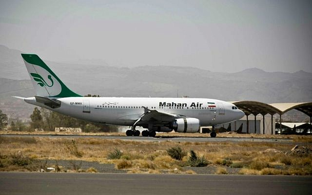 A plane from the Iranian private airline Mahan Air lands the international airport in Sanaa, Yemen, Sunday, March 1, 2015 (AP Photo/Hani Mohammed)