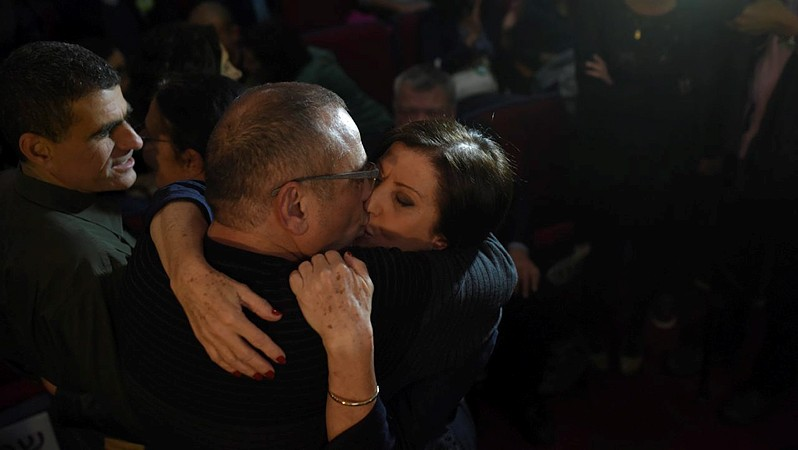 "Zahava Gal On, leader of ""Meretz,"" kisses her husband Pessah at the party headquarters on March 17, 2015. (photo credit: Ben Kelmer/FLASH90)"