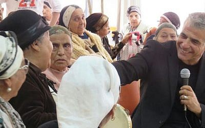Yair Lapid at a day care center for the elderly in Rosh Ha'ayin, March 9, 2015. (Courtesy)