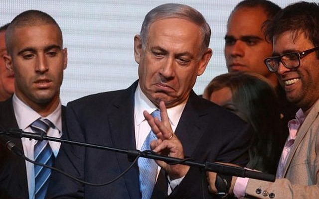 Prime Minister Benjamin Netanyahu reacts to exit poll figures late on March 17, 2015 in Tel Aviv (photo credit: AFP/MENAHEM KAHANA)