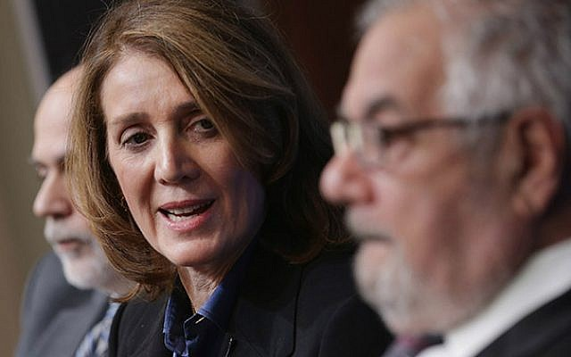 Ruth Porat, who will join Google as its chief financial officer, with the former Fed Chairman Ben Bernanke, left, and former House Financial Services Committee Chairman Barney Frank at a panel discussion at the Brookings Institution in Washington, March 2, 2015. (Chip Somodevilla/Getty Images/JTA)