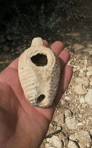 A 1,400 year old ceramic lamp uncovered by a porcupine in Emek Hefer  (photo credit: IAI anti-theft unit)