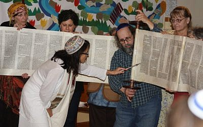 Rabbi Ariel Stone, in white, and the congregants of Shir Tikvah, the only synagogue on Portland's east side. (Gary Teasdale/JTA)