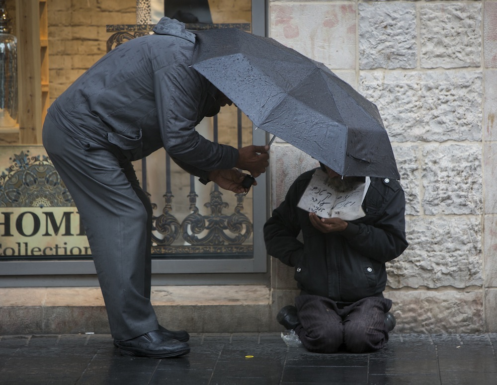A homeless man in Jerusalem. Under Prime Minister Benjamin Netanyahu, Israel has emerged as one of the developed world's most economically unequal countries. (photo credit: Yonatan Sindel/Flash90)