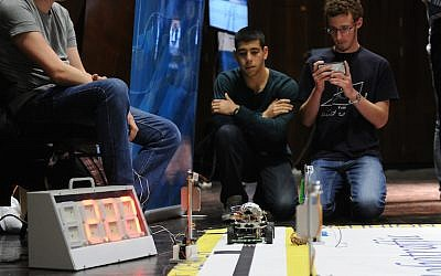 Students watch a self-driving vehicle they designed a the 2015 RoboTraffic competition (Photo credit: Shiatzo Photography Services, Technion's Spokesperson's Office)