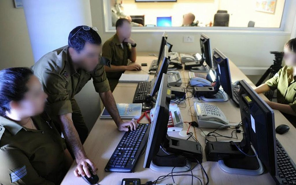 Soldiers and officers from the IDF Military Intelligence Directorate's Unit 9900, which has integrated soldiers with autism into its aerial photography interpretation unit (photo credit: IDF Spokesperson's Unit)