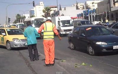 A Jordanian sanitation worker (screen capture: YouTube)