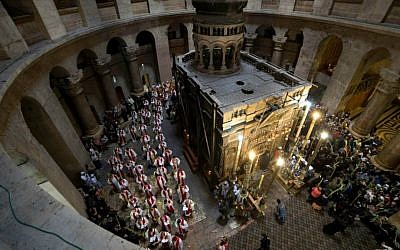 Roman Catholic clergymen carry palm fronds during the Palm Sunday procession at Church of the Holy Sepulchre, traditionally believed by many to be the site of the crucifixion and burial of Jesus, in Jerusalem's Old City, Sunday, March 29, 2015. (AP Photo/Oded Balilty)