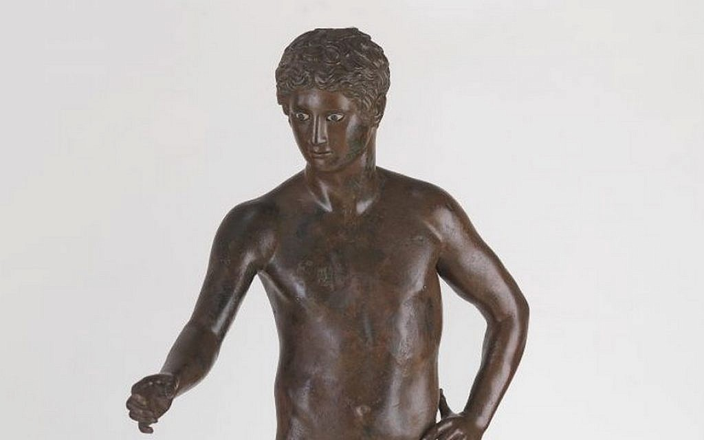 Roman statue of a young god or athlete, provenance unknown, 1st century BCE–1st century CE, bronze, glass from the Belfer Collection (photo credit: © The Israel Museum, Jerusalem, Elie Posner)