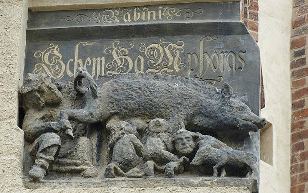 This carving on the facade of Martin Luther's church in Wittenberg, Germany shows Jews suckling at a sow's teat. (Toni L. Kamins/JTA)