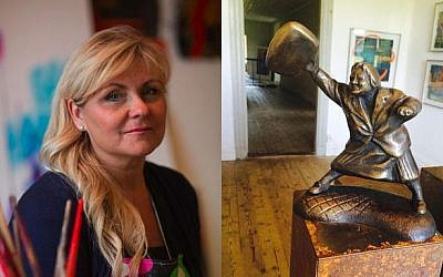The artist Susanna Arwin with a bronze model of Danuta Danielsson hitting a neo-Nazi with her purse. The town council of Växjö has officially denied her bid to put up the sculpture, saying it glorified violence. (Photo credit: courtesy of the artist)