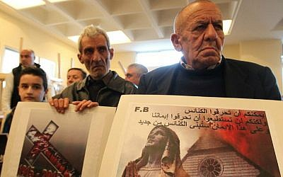 Assyrian Christians, who fled the unrest in Syria and Iraq, attend a prayer for the 220 Assyrian Christians abducted by Islamic State jihadists from villages in northeastern Syria in recent days, at the Saint Georges Assyrian Church in Jdeideh, northeast of the Lebanese capital Beirut, on February 26, 2015. (photo credit: AFP/Anwar Amro)