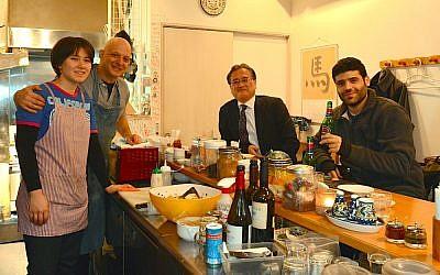 Dan Zuckerman, second from left, at his Tokyo restaurant Ta-im, Dec. 24, 2015. (Cnaan Liphshiz/JTA)