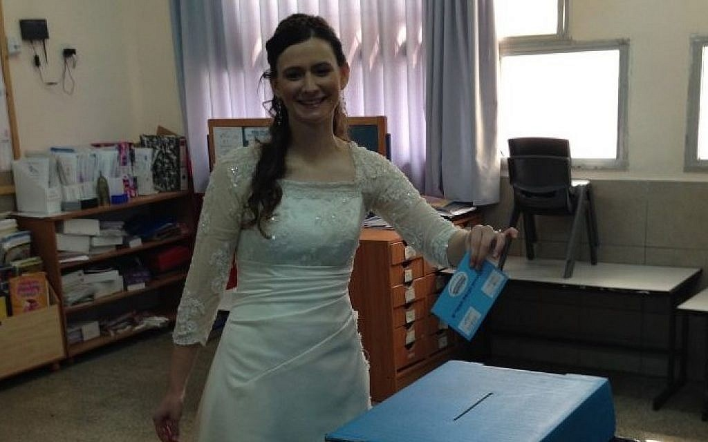 Tamar Kirsch of Ginot Shomron stops off to vote on the way to her wedding, March 17, 2015. (photo credit: Z. S. Lebetkin)