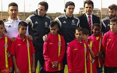 Welsh Football Team plays coexistence football with Jewish and Arab children from northern communities in Israel. The children were handed Welsh football team shirts by the players and manager Chris Coleman. R-L: Joe Ledley, Chris Coleman and Gareth Bale. (photo credit: Kobi Wolf)
