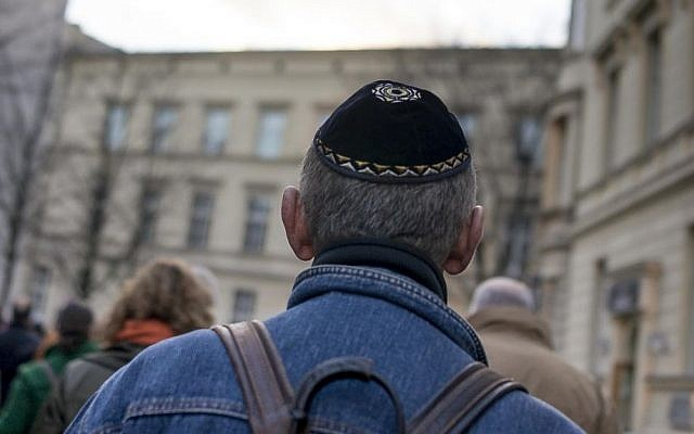 Illustrative: A man wears a yarmulke as he takes part in a silent march to commemorate the 75th anniversary of the Kristallnacht pogroms, Nov. 9, 2013 in Berlin. (Carsten Koall/Getty Images/JTA)