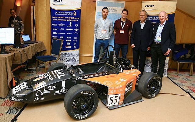 Stef Wertheimer (second right) and Dr. Amir Ziv-Av (far right) stand with Ben Gurion University engineering students at ICME 2015. The students presented a Formula One racecar they designed, March 3 2015 (Photo credit: Courtesy)